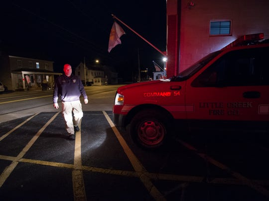 Fire Chief, Michael Scott Bundek, with the Little Creek Fire Company walks to his vehicle after checking for damage in the area after an 4.1 magnitude earthquake struck about 7 miles northeast of Dover Air Force Base at 4:47 p.m.