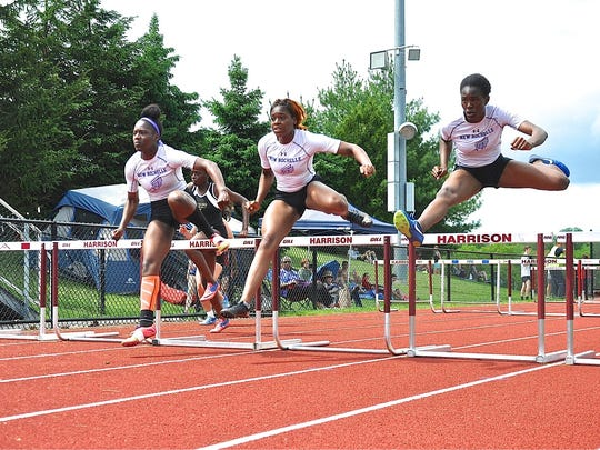(L-R) New Rochelle's Olivia Morgan, Brittney James and Chiamaka Odenigbo sweep the girls 100 hurdles.