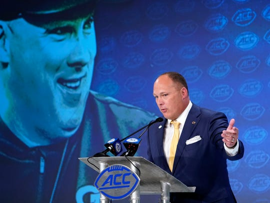 Georgia Tech head coach Geoff Collins speaks during the Atlantic Coast Conference NCAA college football media days in Charlotte, N.C., Thursday, July 18, 2019. (AP Photo/Chuck Burton)