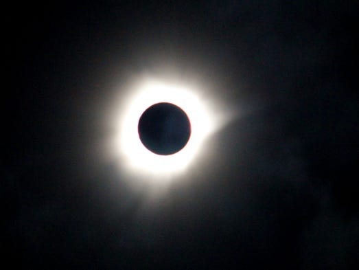 A total solar eclipse is seen in Luwuk, Central Sulawesi,