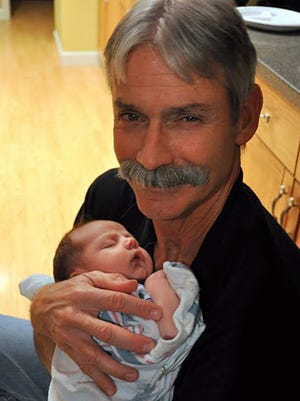 Baby Darwin Costello, cradled by paternal grandfather Murray Costello. Darwin Costello died at 4 months old in June 2010 after suffering severe injuries that his father, Ryan Costello, was later convicted of causing.