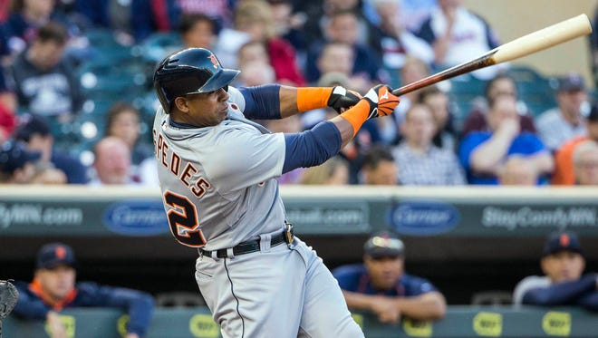 Tigers leftfielder Yoenis Cespedes (52) hits a three run home run in the first inning against the Minnesota Twins at Target Field.
