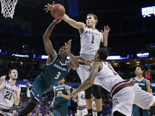 Texas A&M forward D.J. Hogg (1) knocks the ball away from Green Bay guard Khalil Small (3) as Small is fouled by guard Anthony Collins (11) in the second half of a first-round men's college basketball game in the NCAA Tournament, Friday, March 18, 2016, in Oklahoma City. (AP Photo/Sue Ogrocki)