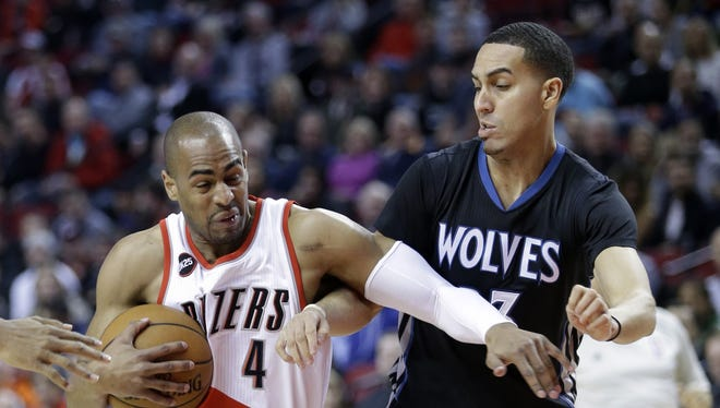 Portland Trail Blazers guard Arron Afflalo, left, drives to the basket against Minnesota Timberwolves guard Kevin Martin during the first half of an NBA basketball game in Portland, Ore., Wednesday, April 8, 2015.