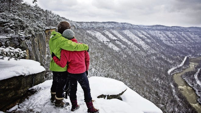 Take in the snow-covered scenery at New River National Park in West Virginia.