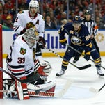 Chicago Blackhawks goalie Scott Darling (33) makes a save against the Buffalo Sabres during the second period Friday at First Niagara Center in Buffalo, N.Y.