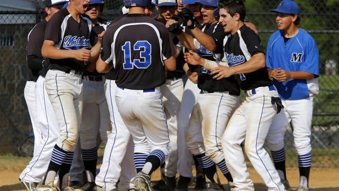 Matt Carovillano (13) of Middlessex is greeted by teammates after hitting a home run against Shore Regional during NJSIAA Central Group I championship at Shore Regional High School. Middlesex won 15-3.West Long Branch,NJ. Friday, May 29, 2015. ASB 0530 Shore Baseball