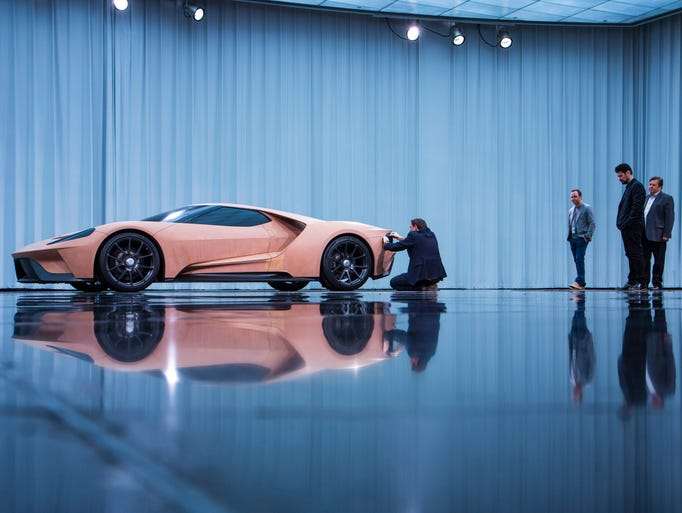 Ford designers admire a clay model of the Ford GT Supercar.