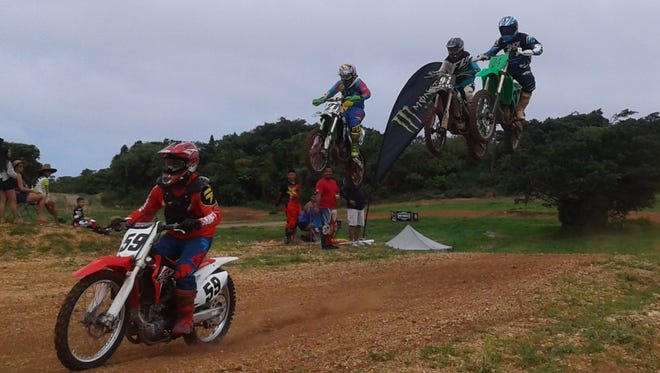 Robert Terrel leads a high flying trio of novice class riders for the eighth round of the Guam Monster Motocross Championships on Sunday, June 25 at the Guam International Raceway.