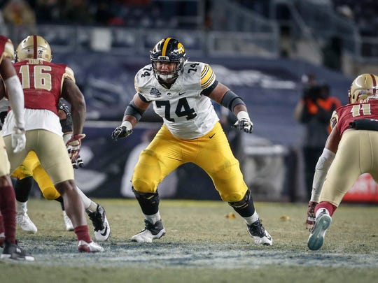 Iowa offensive lineman Tristan Wirfs explodes off the line in an offensive play against Boston College during the 2017 Pinstripe Bowl at Yankee Stadium in Bronx, New York on Wednesday, Dec. 27, 2017.