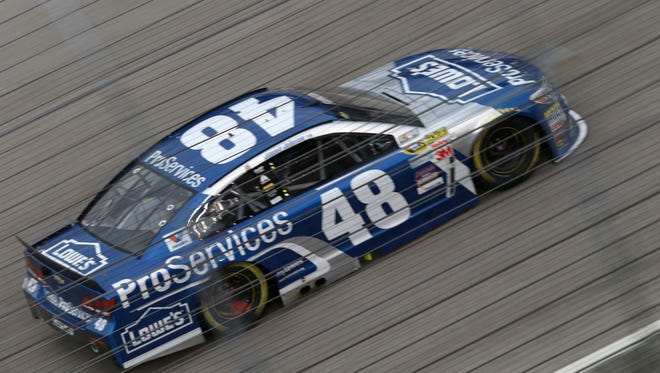 Jimmie Johnson drives on his way to winning the NASCAR Sprint Cup series auto race Saturday at Texas Motor Speedway in Fort Worth, Texas.