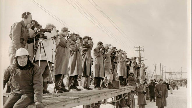 Work crews and photographers prepare for the launch of the S. S. Edward L. Ryerson on Jan. 21, 1960.