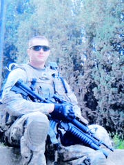 In this undated photo provided by his family, Sgt. Chris Birdwell poses in full combat gear during a tour of Afghanistan.