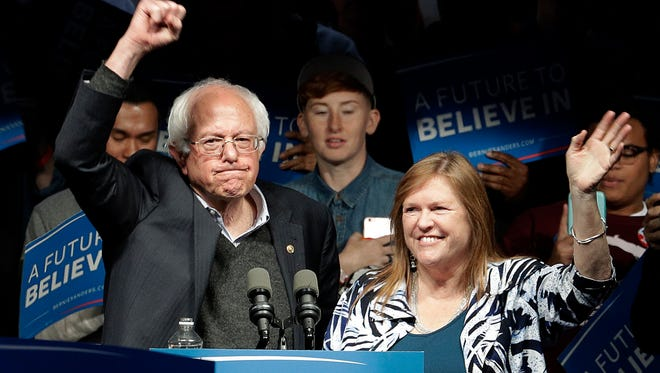 Democratic presidential candidate, Sen. Bernie Sanders, I-Vt., and his wife Jane Sanders, wave after a campaign rally Tuesday in Louisville, Ky. Sanders is visiting