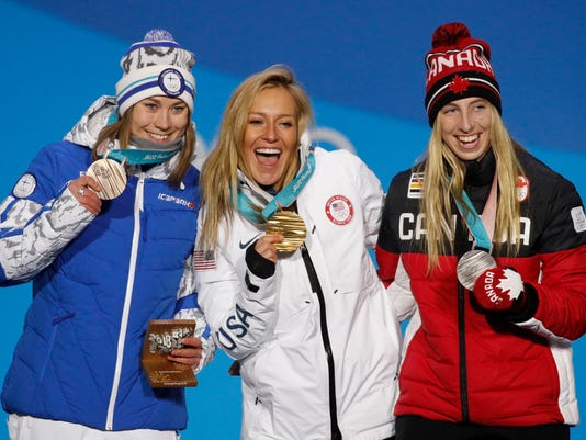 Women's slopestyle medalists, from right, Canada's Laurie Blouin, silver, United States' Jamie Anderson, gold, and Finland's Enni Rukajarvi, bronze, pose during their medals ceremony at the 2018 Winter Olympics in Pyeongchang, South Korea, Monday, Feb. 12, 2018. (AP Photo/Jae C. Hong)