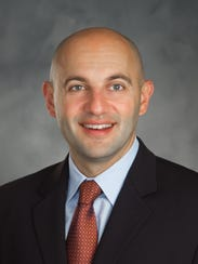 Rafael Axen, MD, was recently promoted to medical director