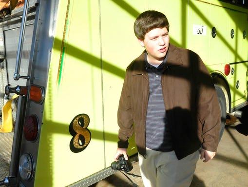 Jonathan Dyer, 17, walks through a Bartlett fire station.