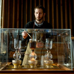 Barista trainer Chris Smith brews a Columbia roast coffee on the siphon at the Starbucks Roastery in Seattle.