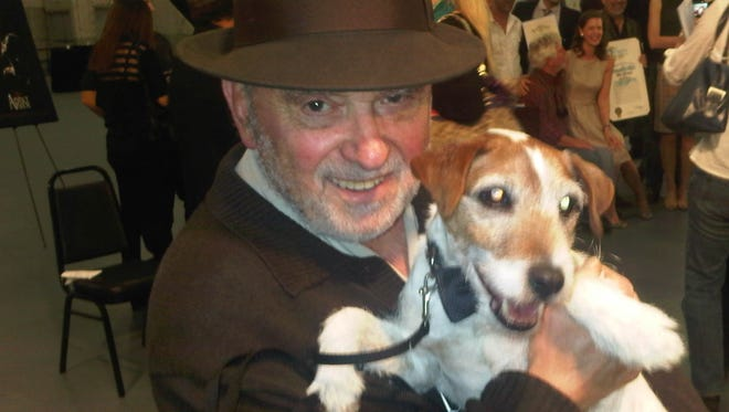 A rare photo of Dick Guttman and a client, Uggie, the dog from 'The Artist in 2011 which Guttman did press for.