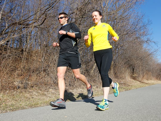 Kirsten Nagel, of Rochester, right, ran the Boston marathon last year and is running again this year, goes for a training run in Rochester Wednesday afternoon, April 9, 2014. With her is her training partner, Travis Money, of Canandaigua.