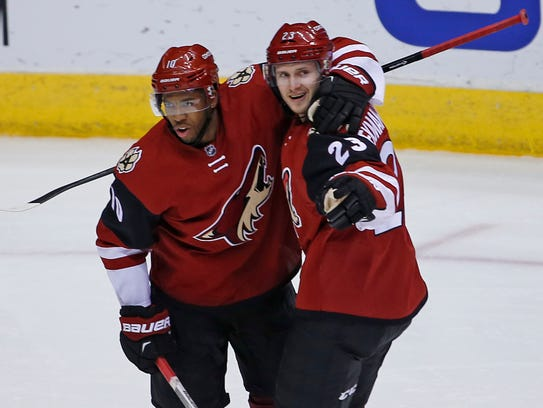 Coyotes' Anthony Duclair celebrates with Oliver Ekman-Larsson