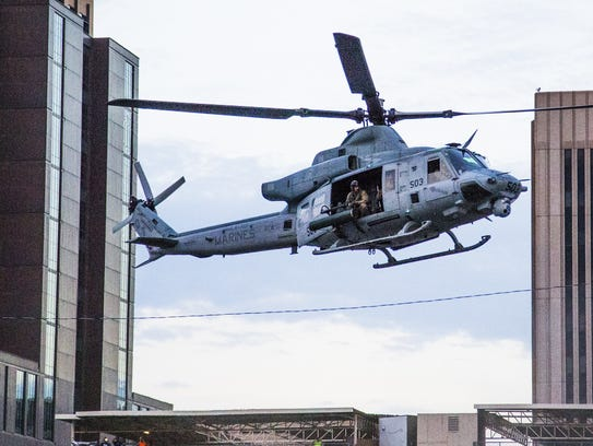 A U.S. Marine UH-1 Huey helicopter lands just west