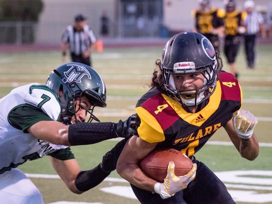 Tulare Union's Darius Baker evades El Diamante's Cameron Beans at the sideline in a non-league high school football game  on Thursday, August 23, 2018.