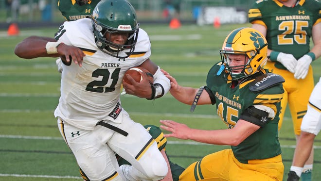 Ashwaubenon Jaguars defender Mike Vannieuwenhoven can't stop running back Henry Geil from scoring for the Preble Hornets Thursday, August 17, 2017 at Goelz Field in Ashwaubenon, Wis.