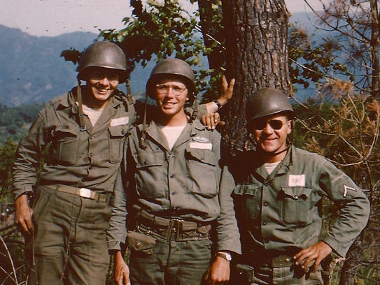 John Phillips, center, and fellow soldiers during the
