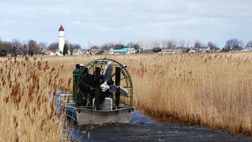 A Michigan Department of Natural Resources airboat  heads out into St. Johns Marsh. People on Harsens Island rescued a man after his airboat crashed Saturday.