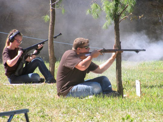 Youth shooters compete with muzzleloaders Tuesday at the NRA YHEC championship.