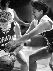 From 1989: Drake's Jan Jensen, left, grabs a loose