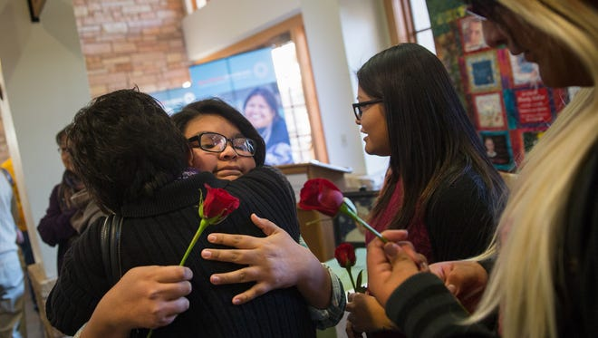 Jade Yazzie, second from left, Takota Yazzie and Franky Yazzie hug family members Wednesday after a ceremony honoring organ donor Jasper Yazzie at San Juan Regional Medical Center in Farmington.