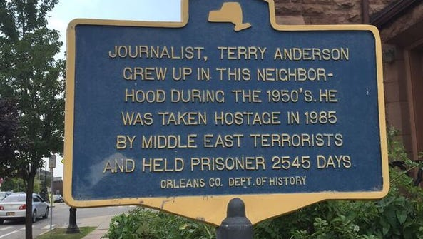 A historical marker in Albion that notes Terry Anderson