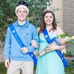 Collin Buck and Olivia Flammand walk to greet their classmates after accepting titles of king and queen during the 51st Coronation Day in CMR's Fieldhouse Thursday, Oct. 8, 2015. Broadway themed performances such as Bison King, a comical CMR adaptation of Lion King, and Seasons of Love from Rent showcased drama, choir and band students' abilities for returning teachers and parents.
