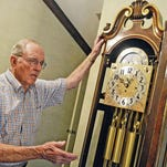 "Stuart Vance shows off some of the finer details of ""The Clock,"" a prototype grandfather clock built in 1970 in Starkville. Vance and his wife, ""Mike,"" recently delivered the clock to Jackson where it will occupy a place of honor in the Governor's Office at the state Capitol."