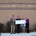 """Members of the Lebanon County Bar Association donated $500 to the Lebanon Rescue Mission recently. Rescue Mission Executive Director Susan Spahr, second from left, accepts a check from attorneys, from left, Andrew Morrow, Heather Eggert, and Loreen Burkett, members of the Lebanon County Bar Association Public Relations Committee. The organization's mission is to """"serve through shelter, nourishment, clothing, education and healthcare,"""" and its ministries include a men's shelter, Agape Family Shelter and Lebanon Free Clinic.The Lebanon County Bar Association is the professional association for attorneys in Lebanon County."""