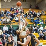 Garrison Rothwell shoots the ball for the Rustlers during the game Friday.