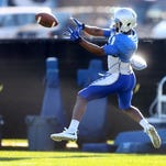 MTSU's Richie James (87) makes a catch during MTSU's football practice, on Tuesday March 22, 2016.