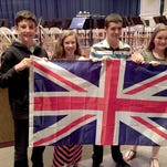 Seth Keller, music teacher at Dover Intermediate School, conducts the bands in the national anthems of the United States of America and Great Britain.