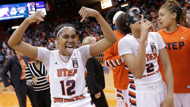 UTEP's Sparkle Taylor, left, and Cameasha Turner celebrate after their 74-68 victory over Arkansas State in the second-round of the WNIT on Monday night at the Don Haskins Center.