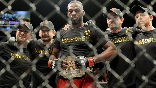 Jon Jones with his corner after defeating Daniel Cormier (not pictured) in their light heavyweight title fight at UFC 182 at the MGM Grand Garden Arena on Jan 3, 2015.