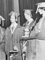 Chris Hitchcock takes the stage during his graduation.