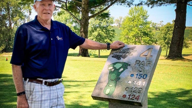 Dunlap resident Terry McKillip, 71, stands at the No. 4 marker on Arrowhead Country Club course, one of the holes where he notched holes-in-one on three straight rounds last week.