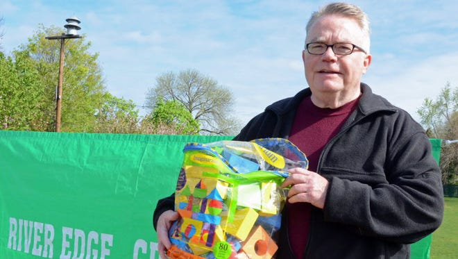 Greg Ogden of the River Edge Green Team with donated toys at last year's River Edge toy drive.