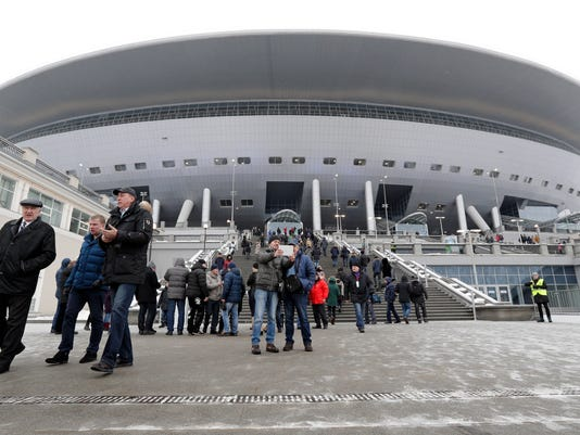 FILE - In this Saturday, Feb. 11, 2017 file photo, spectators visit the new soccer stadium on Krestovsky Island in St. Petersburg, Russia. After years of controversy, Russian officials think their World Cup has weathered the storm. Questions have receded over the legitimacy of the 2010 vote that gave Russia the tournament, the stadiums are either finished or nearing completion, and the Confederations Cup is going smoothly. (AP Photo/Dmitri Lovetsky, File)
