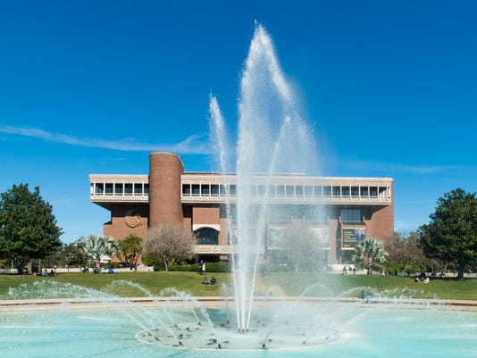 635596888673609275-UCF-Buildings-Reflecting-Pond-front