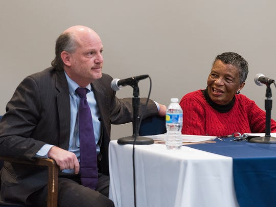 Beb Coker (right), activist, smiles at remarks made by Delaware Supreme Court Chief Justice Leo E. Strine, Jr. at a panel discussing race at the Delaware History Museum in Wilmington on Thursday.