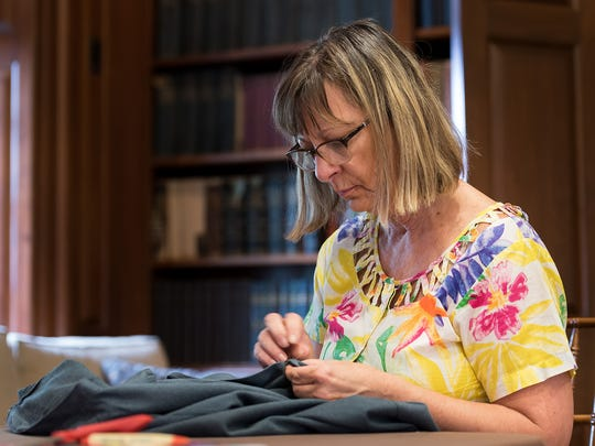 Lora Englehart of West Chester, PA, sews clothing at an event by Mending Lives One Stitch at a Time,  a New Castle based organization that repurposes donated clothing and school uniforms for the homeless and people on fixed incomes, at Buena Vista Conference Center in New Castle on Saturday.
