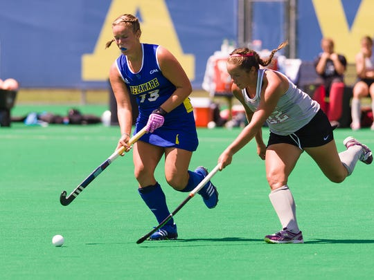 Kayla Devlin (#13) competes for the ball against Kelsey Nolan (#22) of Ohio State in Delaware's field hockey season opener at Rullo Stadium Saturday.